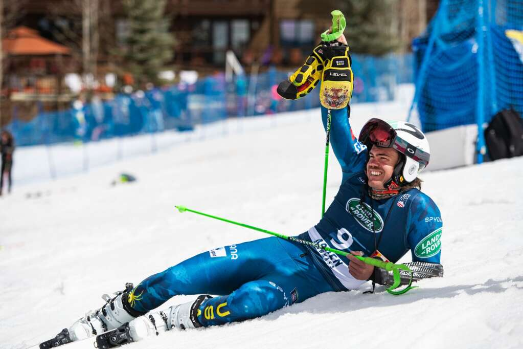 Aspen local alpine skier Bridger Gile relaxes on the ground outside of the U.S. Alpine Men's Giant Slalom Championships course at Aspen Highlands on Tuesday, April 6, 2021. Gile finished in third place. (Kelsey Brunner/The Aspen Times)