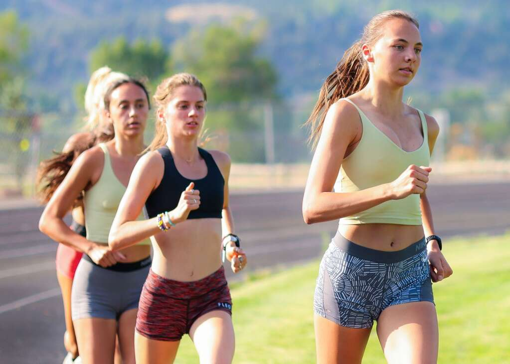 Basalt High School sophomore Katelyn Maley, right, paces the pack during practice on Tuesday, June 22, 2021, in Basalt. Photo by Austin Colbert/The Aspen Times.