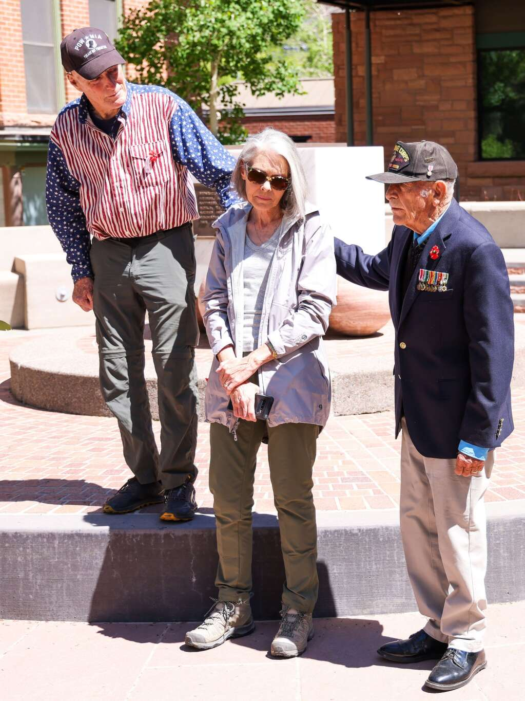 Veterans Dick Merritt, right, and Dan Glidden, left, stand with Susan Gomes, wife of the late Pepper Gomes, during the annual Memorial Day ceremony on Monday, May 31, 2021, at Pitkin County Veterans Memorial Park in Aspen. Photo by Austin Colbert/The Aspen Times.