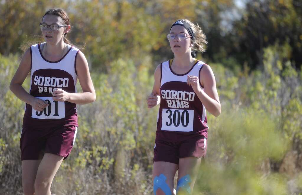 Soroco junior Trinity Delto, left, runs with a teammate at a cross country meet at Loudy-Simpson Park in Craig on Saturday morning.   Shelby Reardon/Steamboat Pilot & Today