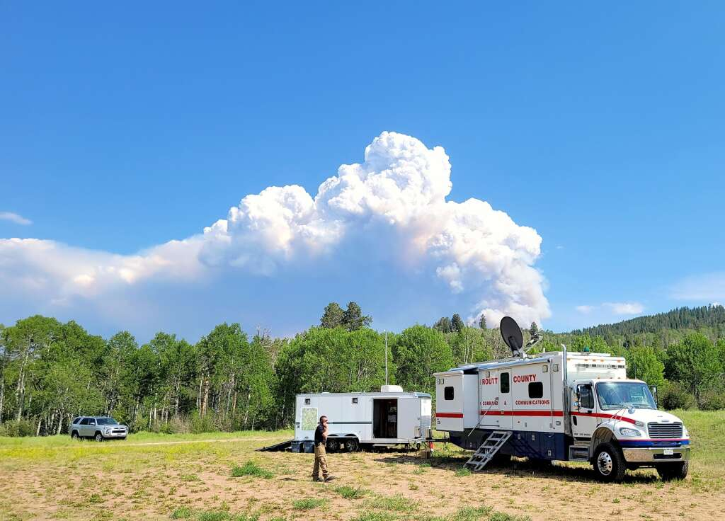 The smoke plume from the Muddy Slide Fire visible June 21 at the command center for the fire. (Photo by Dylan Anderson)