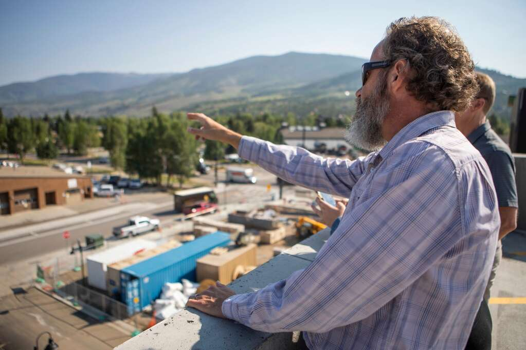 Silverthorne Town Manager Ryan Hyland talks about construction at the Fourth Street Crossing development on top of the new parking garage in Silverthorne on Tuesday, July 20. | Photo by Tripp Fay / Tripp Fay Photography