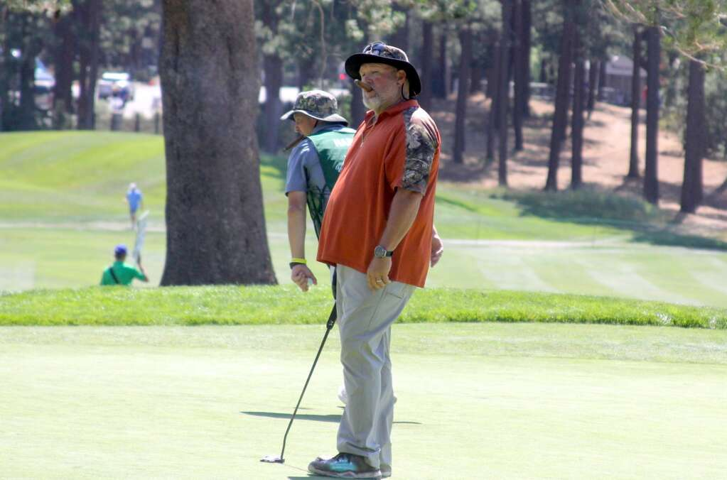 Larry the Cable Guy reacts to a missed putt.