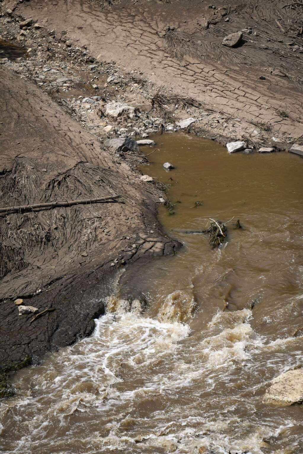 Mud, rocks and debris block a portion of the Colorado River near MM 129 after recent rain caused mudslides in Glenwood Canyon.  |Chelsea Self / Post Independent