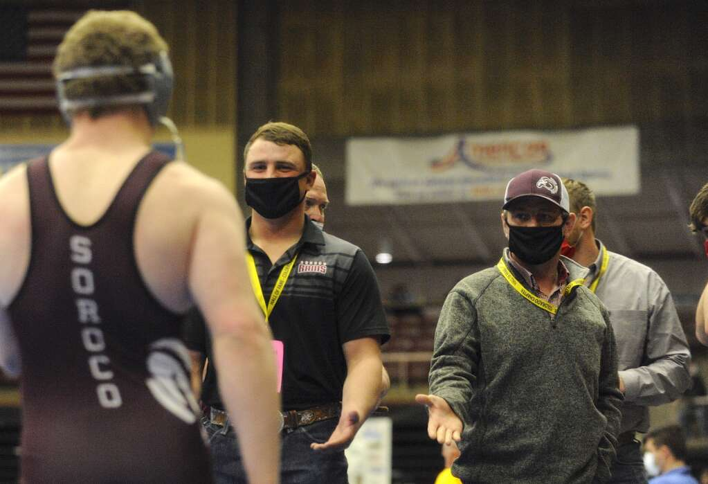Soroco graduate and former state champion Jace Logan congratulates his brother, senior Kody Logan, after he earns a spot in the championships match at the CHSAA State Wrestling Championships at the Southwest Event Center in Pueblo on Friday.
