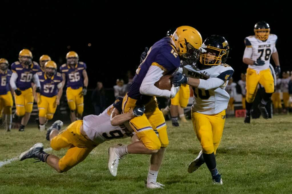 Basalt's Luke Rapaport (12) takes a tackle by Rifle during the varsity game at the Longhorns' stadium on Friday, Oct. 22, 2021. | Kelsey Brunner/The Aspen Times