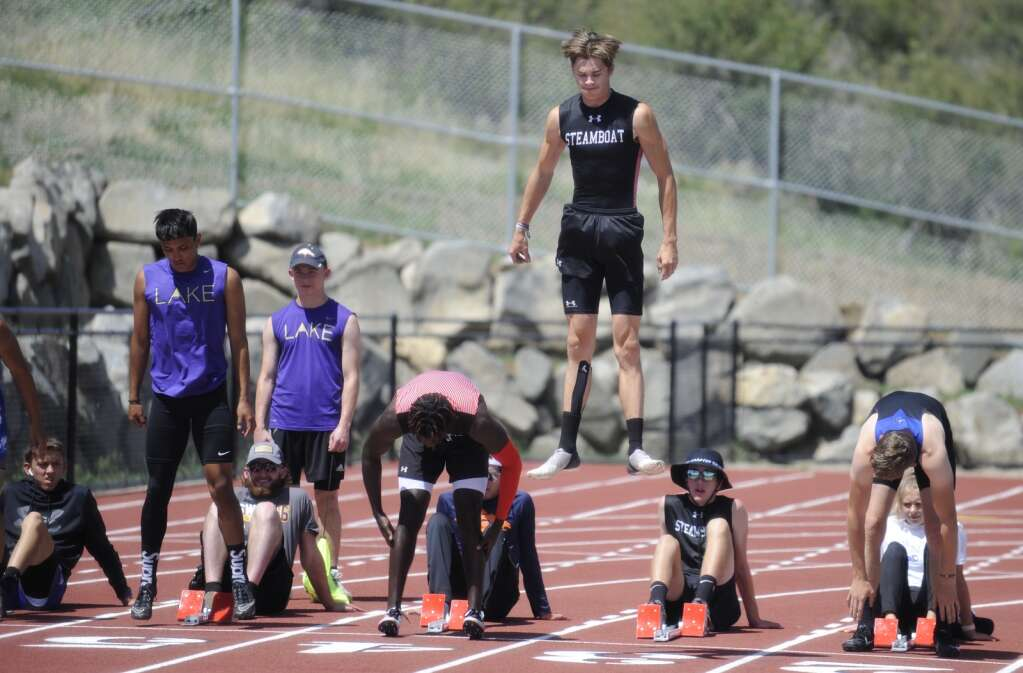 Josh Hamilton bounces into the air to prepare for the 100 meter race at the Bulldog/Tiger Invite at Hayden High School on Wednesday. (Shelby Reardon)