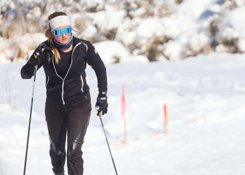 Kate Oldham prepares for an AVSC cross-country ski race on Saturday, Feb. 6, 2021, near the AVSC Clubhouse. Photo by Austin Colbert/The Aspen Times.