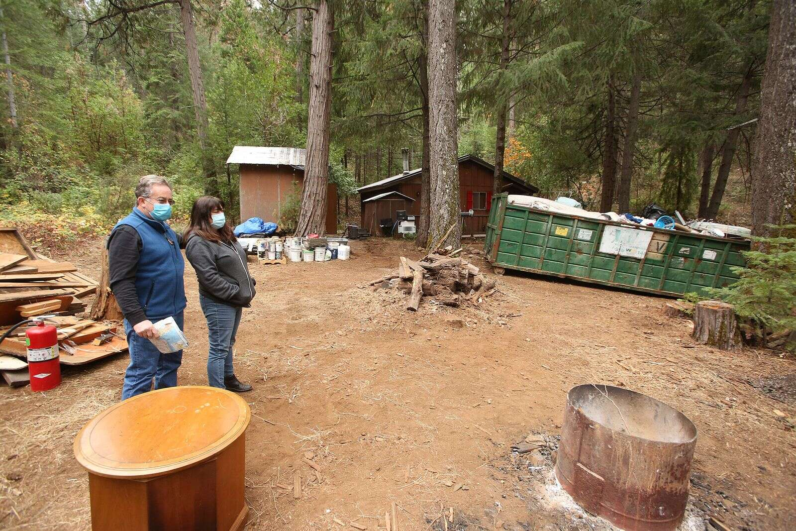 Lisa Marlowe and her husband Bob stand on her mother's property in Nevada City that was ransacked and overrun by squatters this year off of Cooper Road. After extensive cleanup efforts and help from friends, the property is starting to look like home again.   Photo: Elias Funez