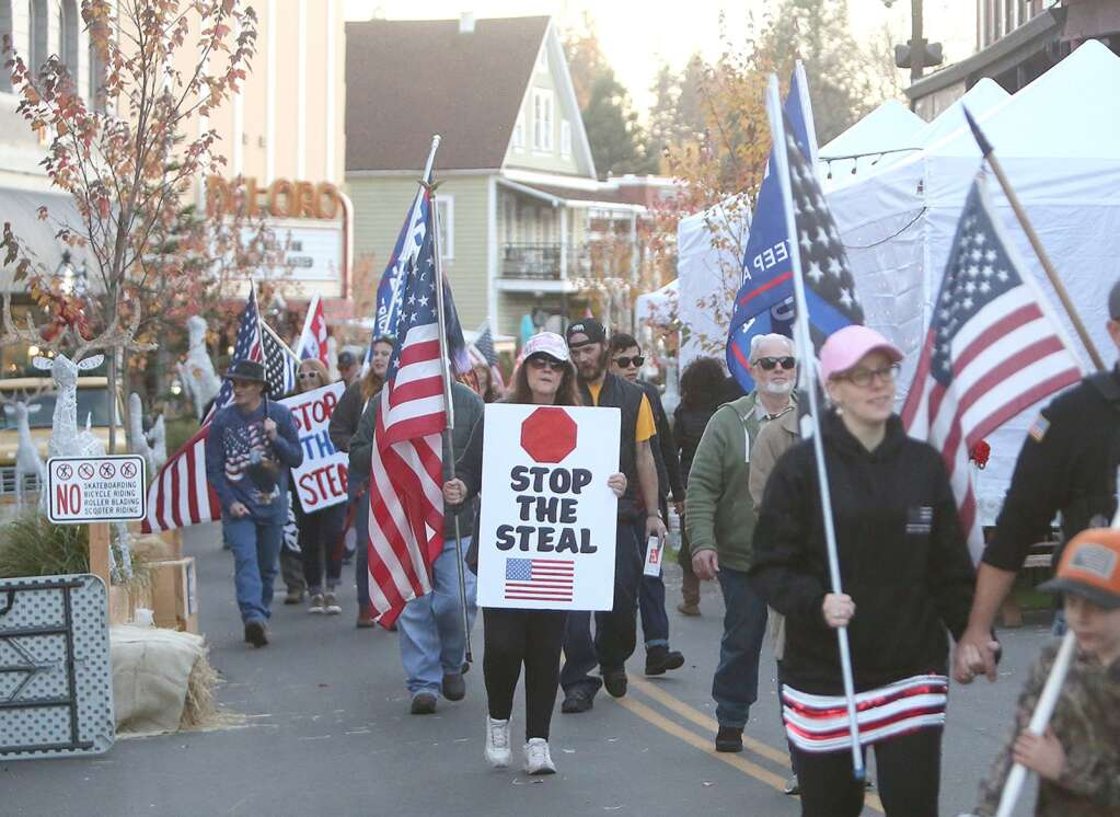 Stop the steal protesters for President Trump join Back the Blue Nevada County as they march along Mill Street in downtown Grass Valley Nov. 29 prompting a police presence to keep an eye on the event. | Photo: Elias Funez