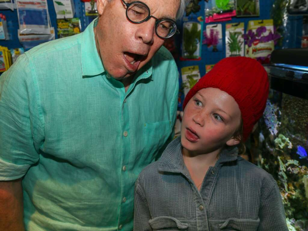 Author Greg Lewis joins his granddaughter, Brooklyn Lewis, at Rocky Mountain Pet Shop on Thursday, March 4, 2021, in downtown Aspen. Photo by Austin Colbert/The Aspen Times.