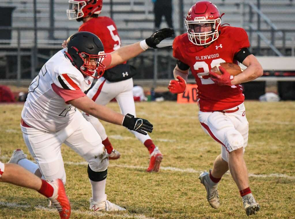 Glenwood Springs Demon Garrett Dollahan tries to run around the defending Aspen Skier during Friday night's season opener against at Glenwood Springs High School. |Chelsea Self / Post Independent