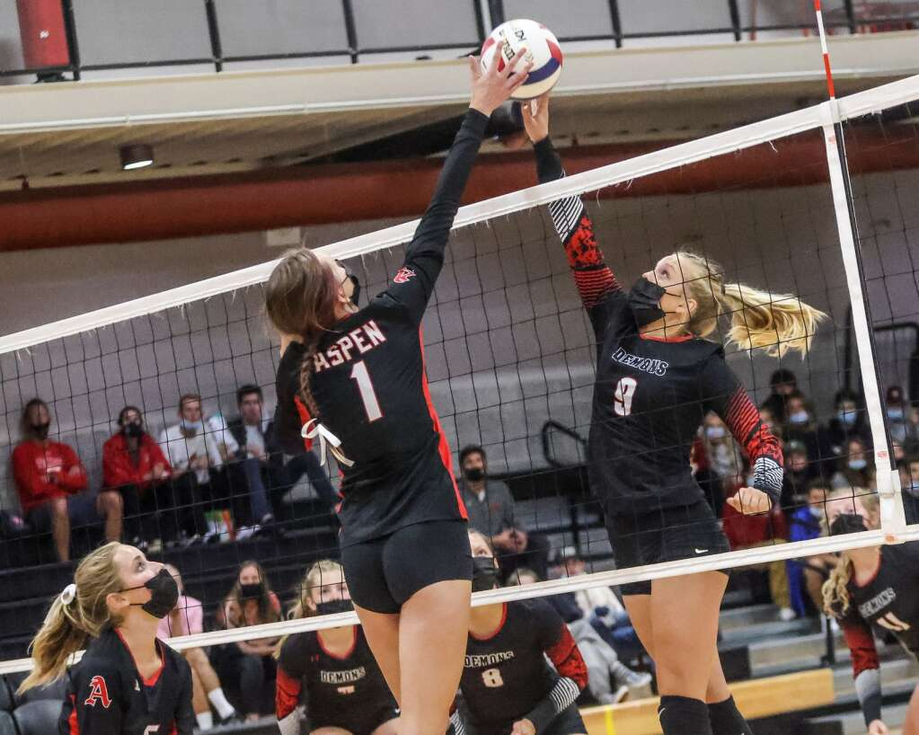 Aspen High School's Sadie Bayko, left, attempts to make a block as the AHS volleyball team hosts Glenwood Springs on Thursday, Aug. 19, 2021, inside the AHS gymnasium. The Skiers won, 3-2. Photo by Austin Colbert/The Aspen Times.