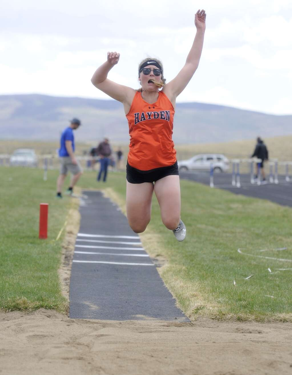 Hayden junior Alison Rajzer leaps towards the triple jump pit at the Clint Wells Invitational in Craig on Friday. (Photo by Shelby Reardon)