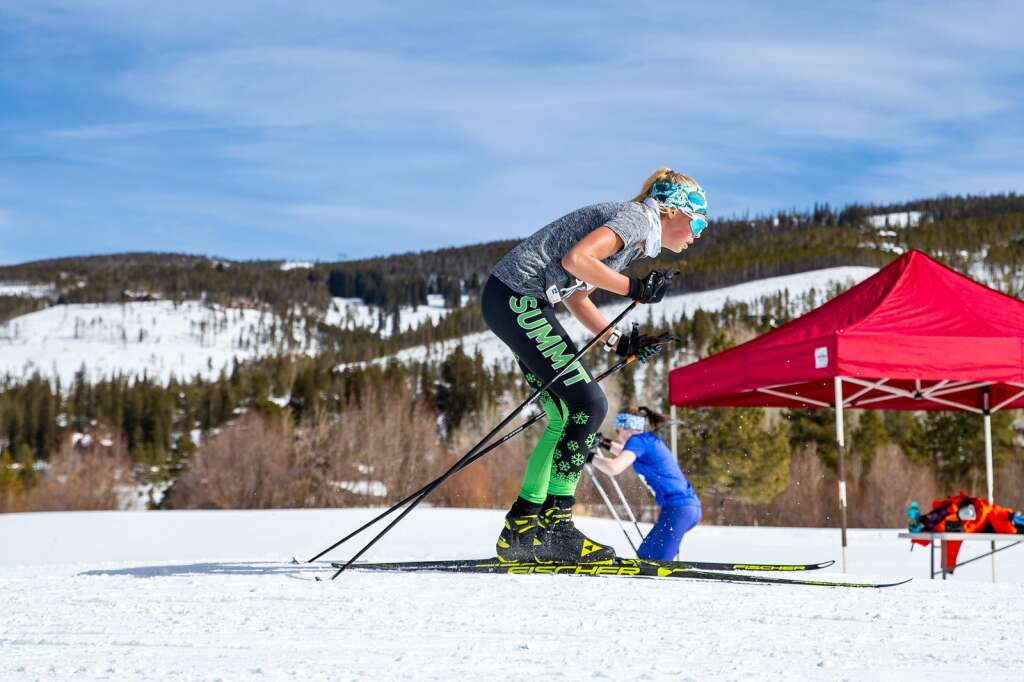 Summit's Lili Zygulski crosses the finish line of the 3K girls skate race at the Colorado Nordic Ski State Championships on March 6 at Gold Run Nordic Center in Breckenridge. | Photo by Liz Copan / Studio Copan
