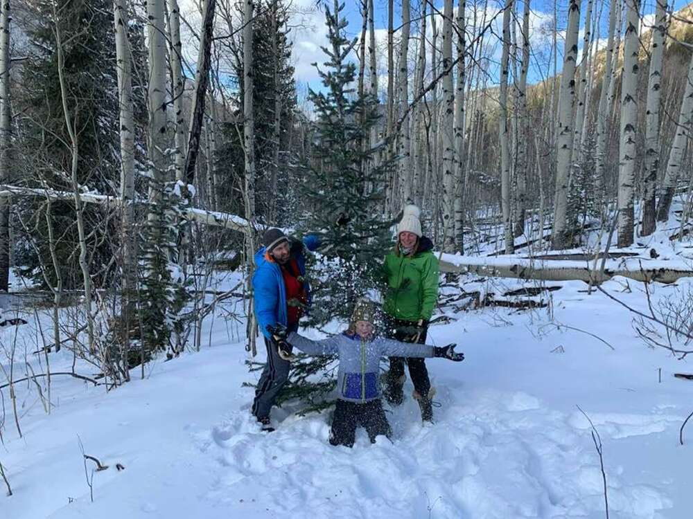 Dave, Devon and Ali Phillips finding their tree on Thanksgiving. Morgan Phillips photo.