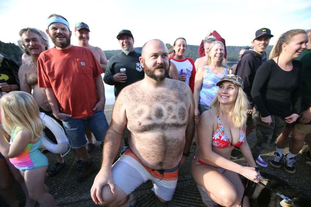 Folks decorated themselves in all different types of manners before taking the icy plunge into Scotts Flat for the polar bear plunge Jan 1 2020. | Photo: Elias Funez