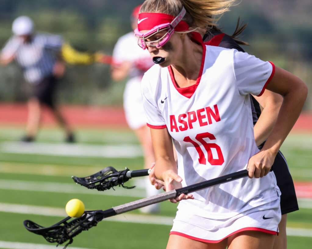 Aspen High School junior Lindsey Heinecken corrals the ball in the girls lacrosse game against Castle View in the Class 4A state quarterfinals on Saturday, June 19, 2021, on the AHS turf. The Sabercats won, 10-9. Photo by Austin Colbert/The Aspen Times.