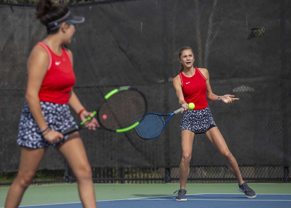 Park City High School senior Lauren Allen, right, returns a volley during her first doubles matchup against Murray High School at the PC MARC Thursday afternoon, Sept. 23, 2021. Allen and her doubles partner, senior Daniela Santos, have been playing together for four years. (Tanzi Propst/Park Record)