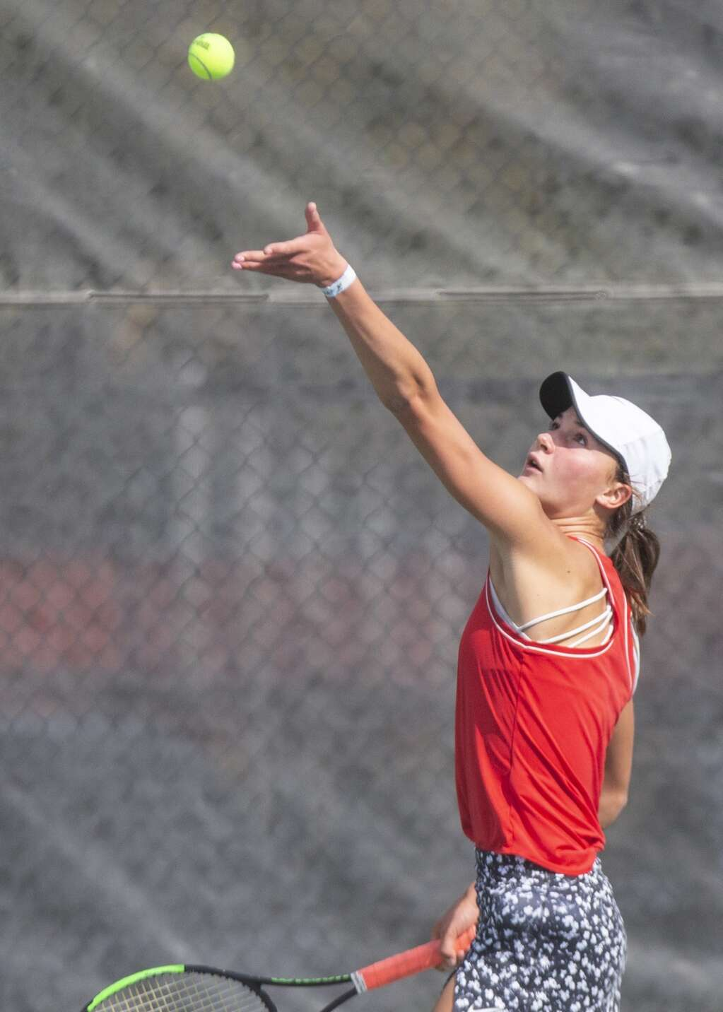 Park City High School's Reagan Harrison tosses the ball up as she serves during her third singles matchup against Provo High School's Sally Otterstrom at the Liberty Park tennis complex as part of the UHSAA 5A girls tennis championships Thursday morning, Oct. 7, 2021. (Tanzi Propst/Park Record)