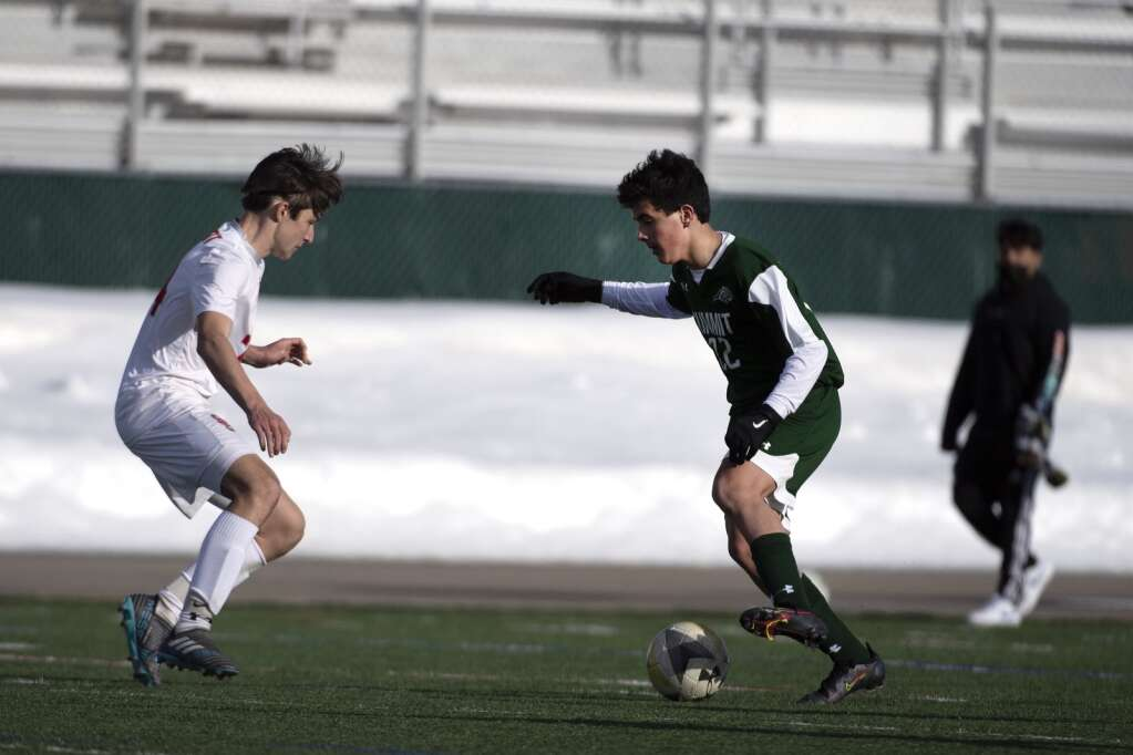 Summit High Tiger Owen Gallo controls the ball against a Steamboat Springs defender during the home opener of the boys varsity soccer season at Climax Molybdenum Field at Tiger Stadium on Thursday, March 18, 2021. The Tigers lost to the Sailors 3-0. | Photo by Jason Connolly / Jason Connolly Photography