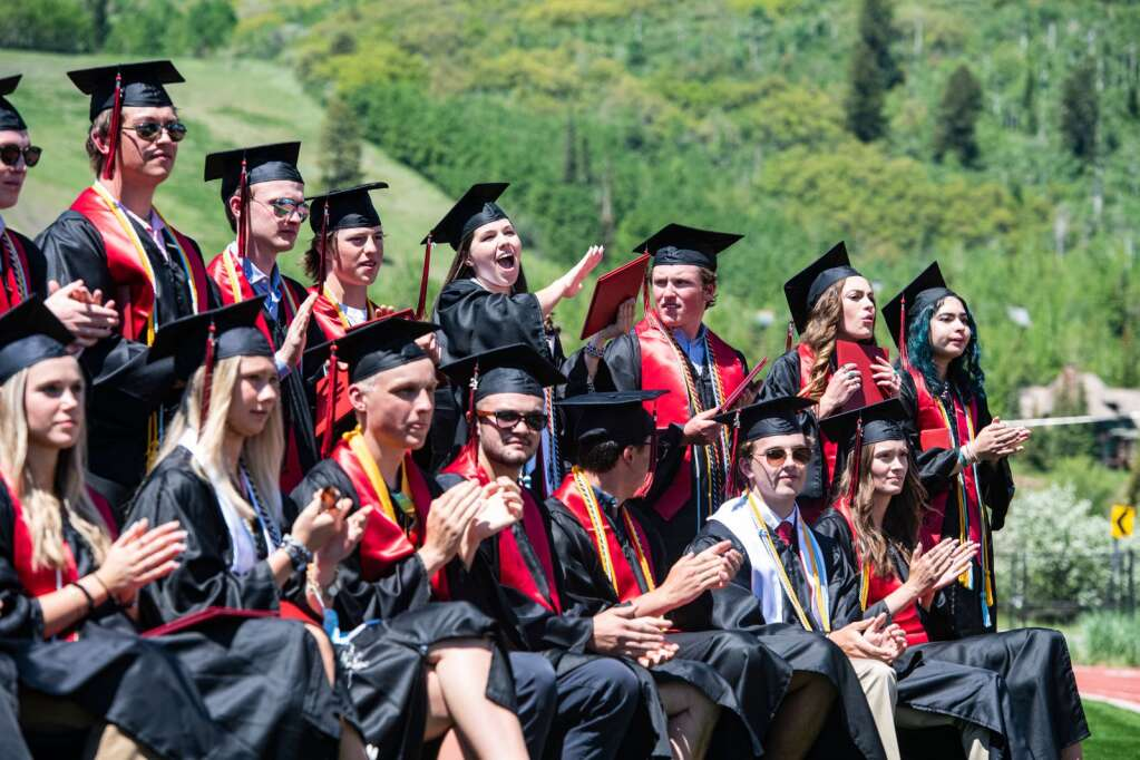 Aspen High School graduates cheer for their classmates as they cross the stage during the commencement ceremony on Saturday, June 5, 2021. (Kelsey Brunner/The Aspen Times)