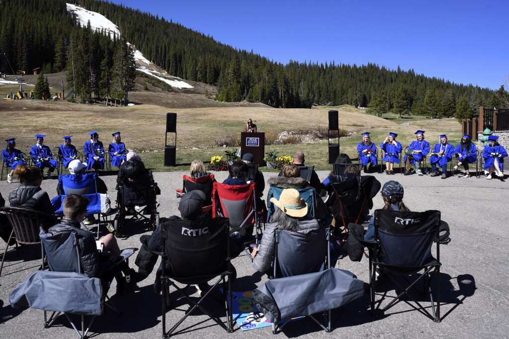 Guests listen as teacher Karin Mitchell speaks during The Peak School graduation at Copper Mountain Resort on Thursday, May 27.   Photo by Jason Connolly /Jason Connolly Photography