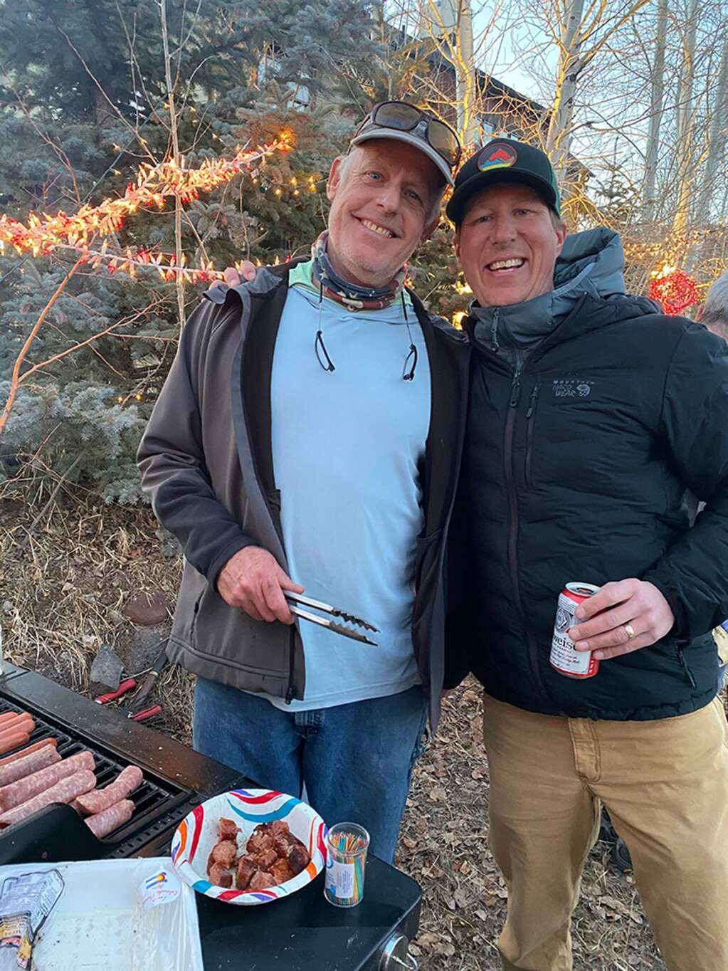 Jay Coarsey tends to the grill with support from Tim Power-Smith.