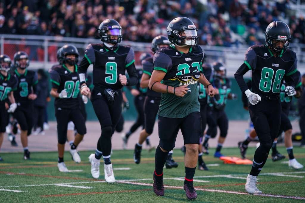 The Summit High School varsity football team takes the field for their homecoming game against the Middle Park Panthers on Friday, Sept. 24, at Tiger Stadium in Breckenridge. | John Hanson/For the Summit Daily News