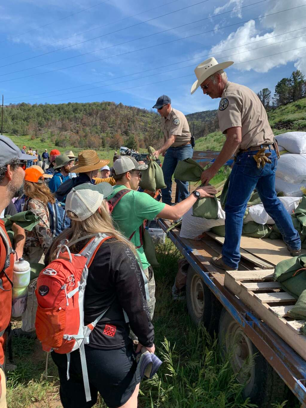 Volunteers collect seed from Colorado Parks and Wildlife officials during a 2019 project. | RFOV/courtesy photo