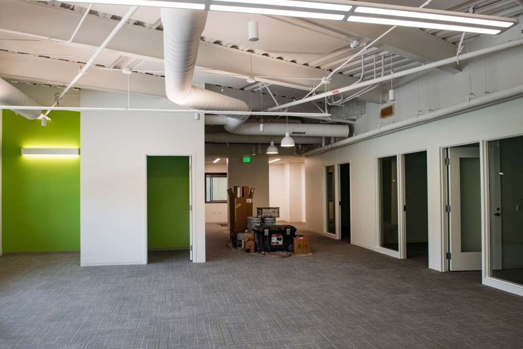 The new Aspen Town Hall is decorated with the green Aspen City logo in the color of the walls and carpet in the conference rooms.  (Kelsey Brunner / The Aspen Times)