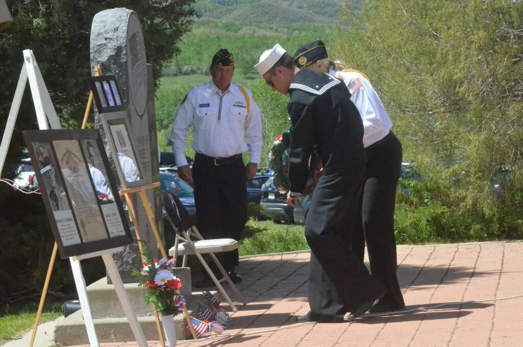 A wreath honoring veterans who have died was placed on a memorial at Steamboat Springs Cemetery Monday during a Memorial Day Ceremony. (Photo by Dylan Anderson)