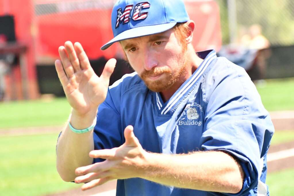Coach Brian Jennings of Moffat County High School baseball claps for his team Monday during the baseball playoffs in Denver.   Andy Bockelman / For the Craig Press