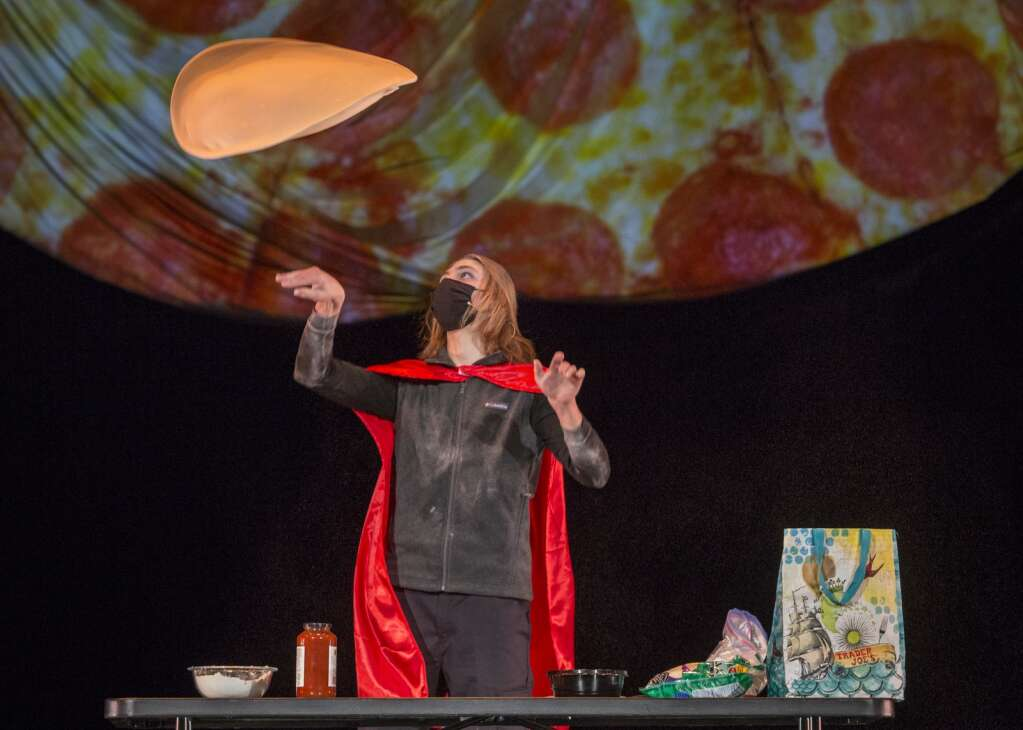 Jack Engel, dressed as Avengers' Thor, tosses pizza dough in the air during the talent portion of the Park City High School Dance Company's Mr. Miner Pageant fundraiser at the Eccles Center Thursday evening, March 11, 2021. (Tanzi Propst/Park Record)