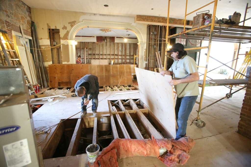 Sierra Foothills Construction superintendent Ken Porter (right) helps address some ducting issues with workers in January at the historic Holbrooke Hotel which has been restored and re-opened in downtown Grass Valley. | Photo: Elias Funez