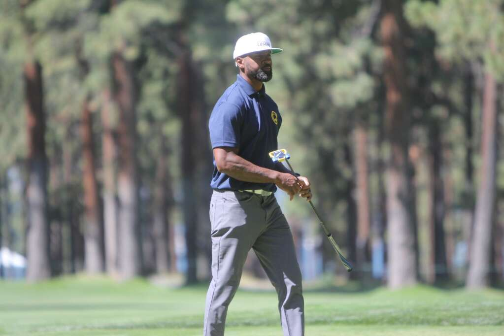 Jimmy Rollins watches a putt.