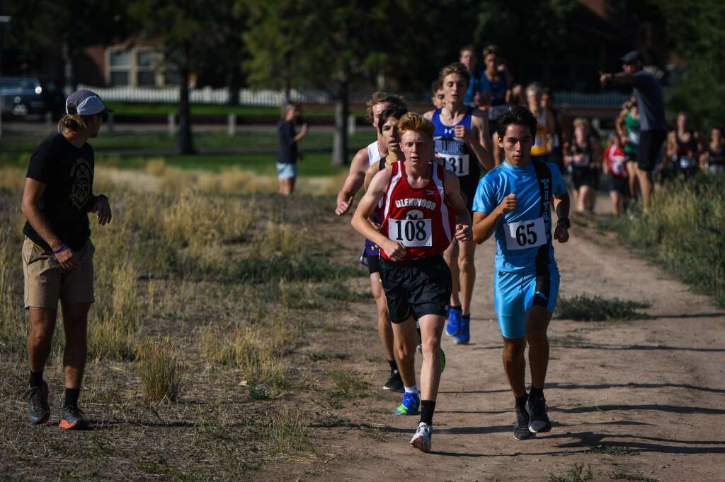 Glenwood Springs and Coal Ridge runners Ben Swanson and Tyler Parker lead the pack during Friday's meet hosted by Coal Ridge High School at VIX Park in New Castle. |Chelsea Self / Post Independent