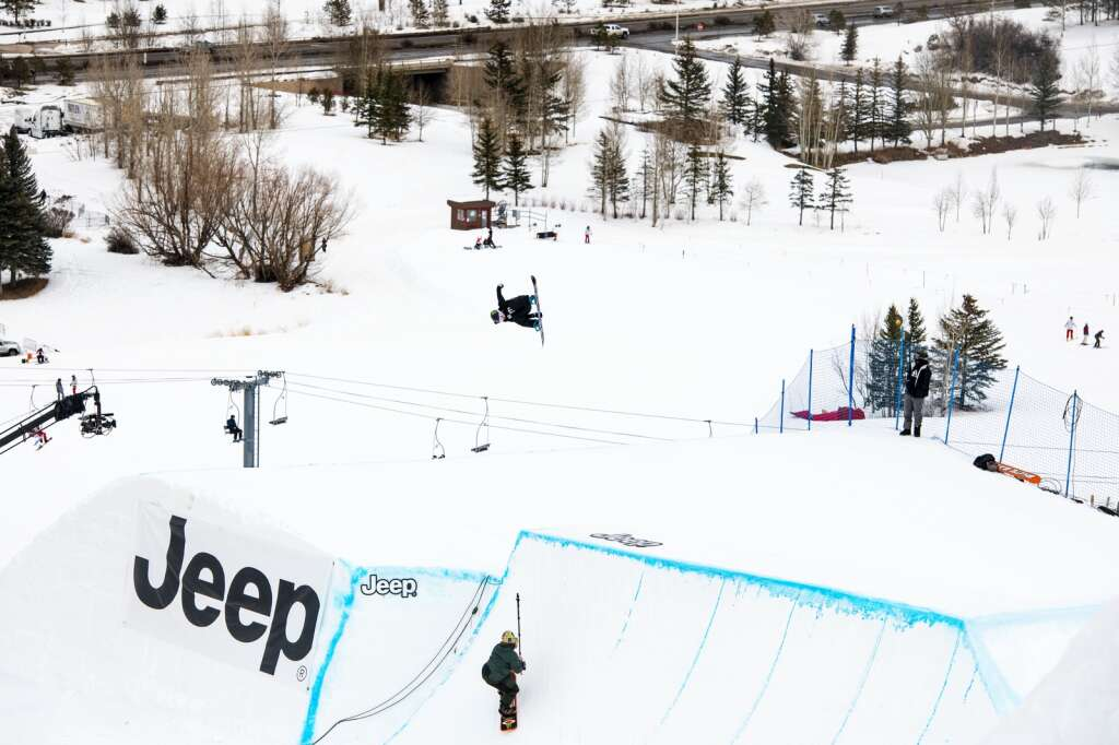 Jamie Anderson hits the final feature on the slopestyle course during her last run of the womens snowboard slopestyle finals at the 2021 X Games Aspen at Buttermilk on Friday, Jan. 29, 2021. Anderson won her 7th gold medal in slopestyle. (Kelsey Brunner/The Aspen Times)