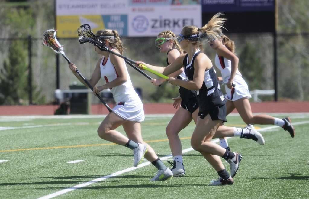A Steamboat Springs girls lacrosse player gets some distance between her and the opponent during a home game against Battle Mountain on Wednesday evening. (Shelby Reardon)