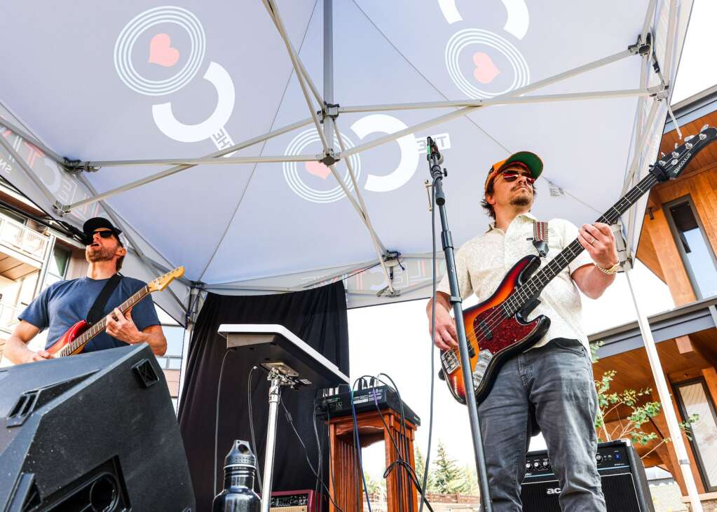 The Snowmass-based band Nearly Now, comprised of Andy Gunion, left, and Brian Harrier, performs in front of The Collective on Saturday, July 10, 2021, in Snowmass Base Village. Photo by Austin Colbert/The Aspen Times.