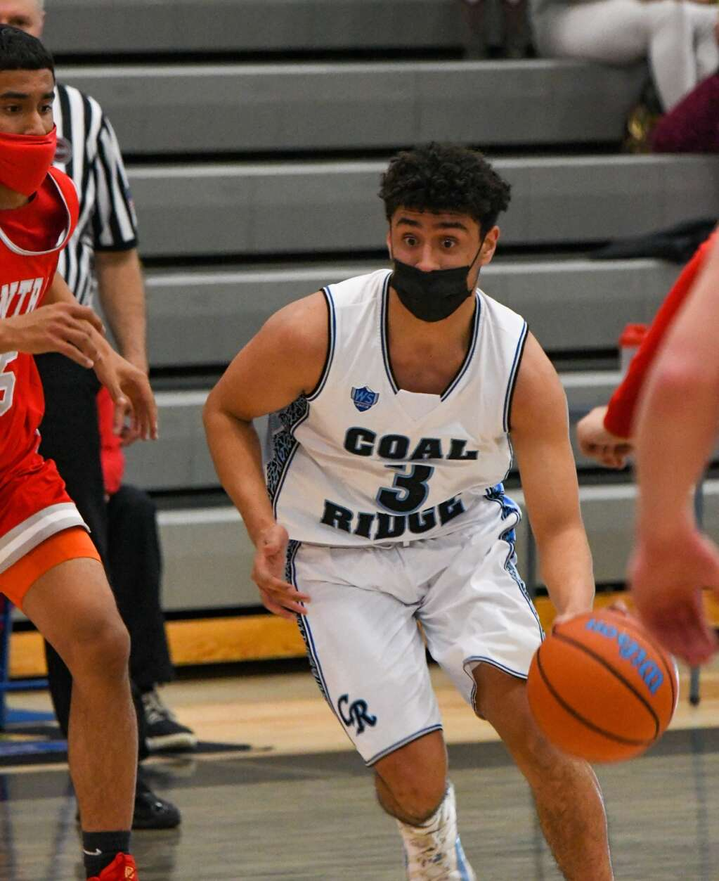 Coal Ridge Titan Moises Contreras dribbles through the defending Grand Junction Central Warriors during Thursday night's game.  |Chelsea Self / Post Independent