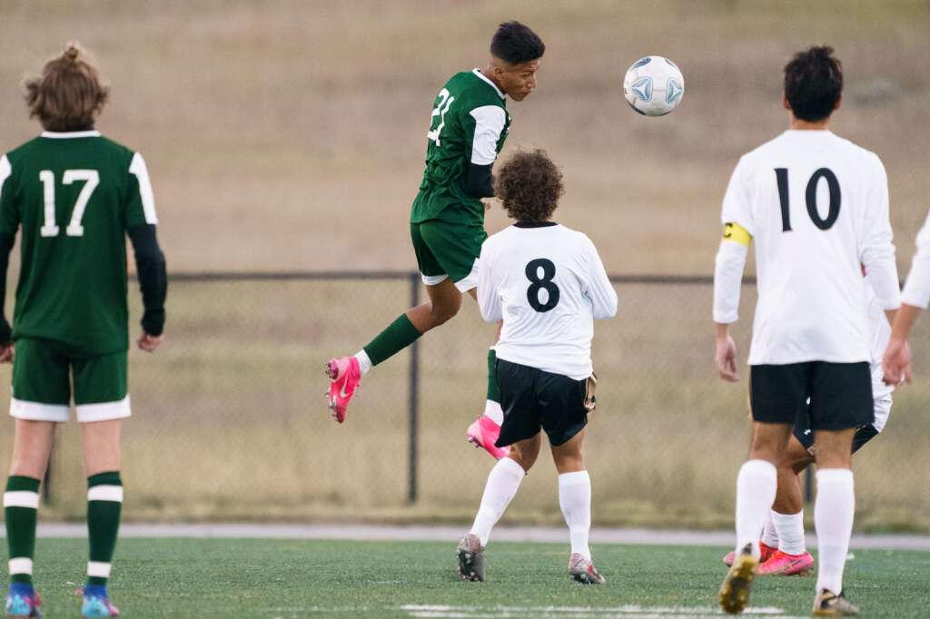 Summit forward Fabian Cuevas heads the ball toward a teammate during the Summit Tigers homecoming match against Battle Mountain on Tuesday, Sept. 21, at Tiger Stadium in Breckenridge. | John Hanson/For the Summit Daily News