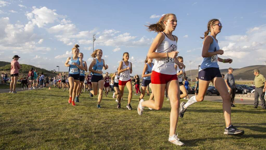 Girls varsity runners head out onto the trails of Round Valley during the Park City High School invitational cross country meet Friday afternoon, Sept. 10, 2021. (Tanzi Propst/Park Record)