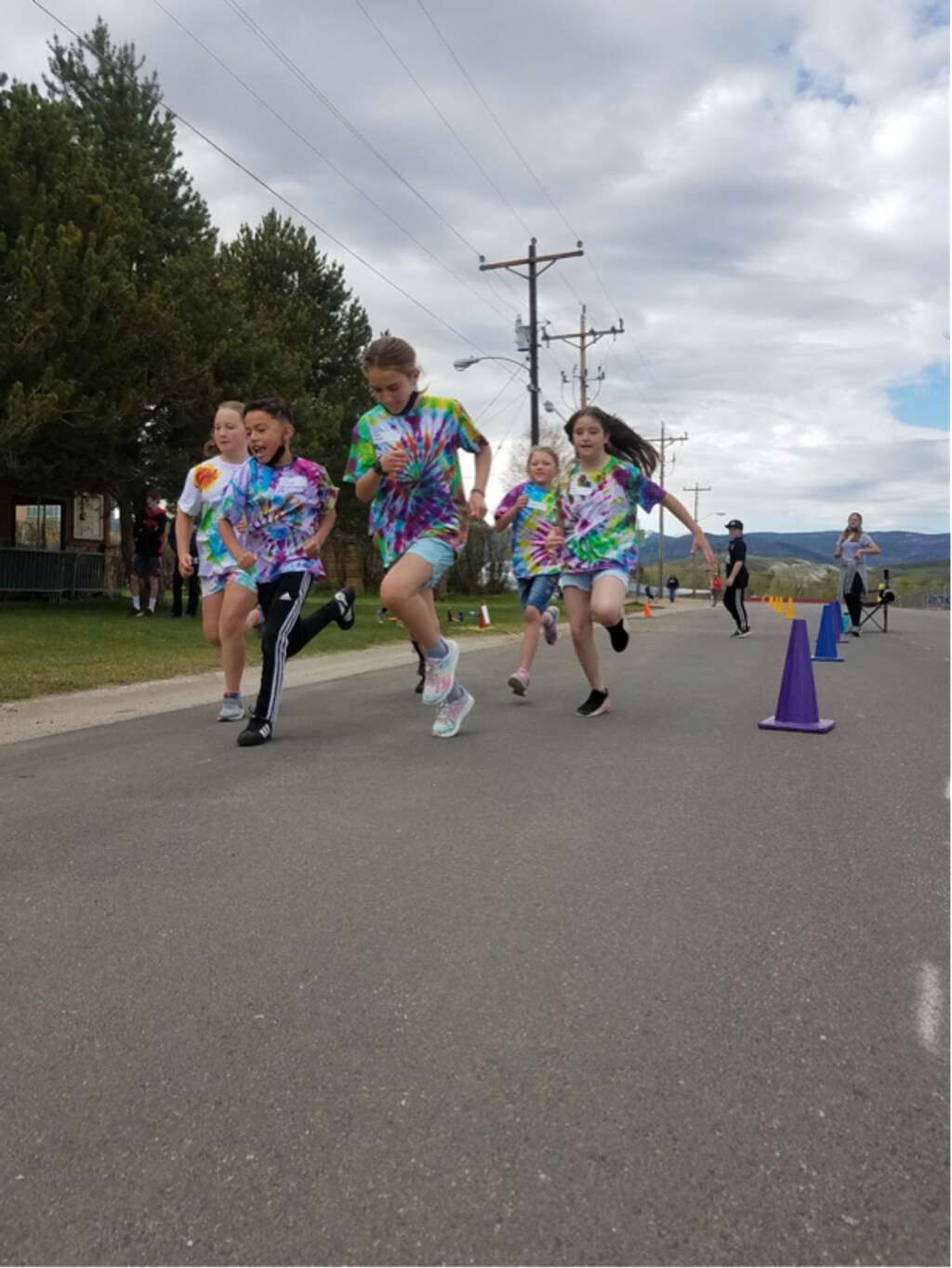 Students race in the Granby Elementary field day.
