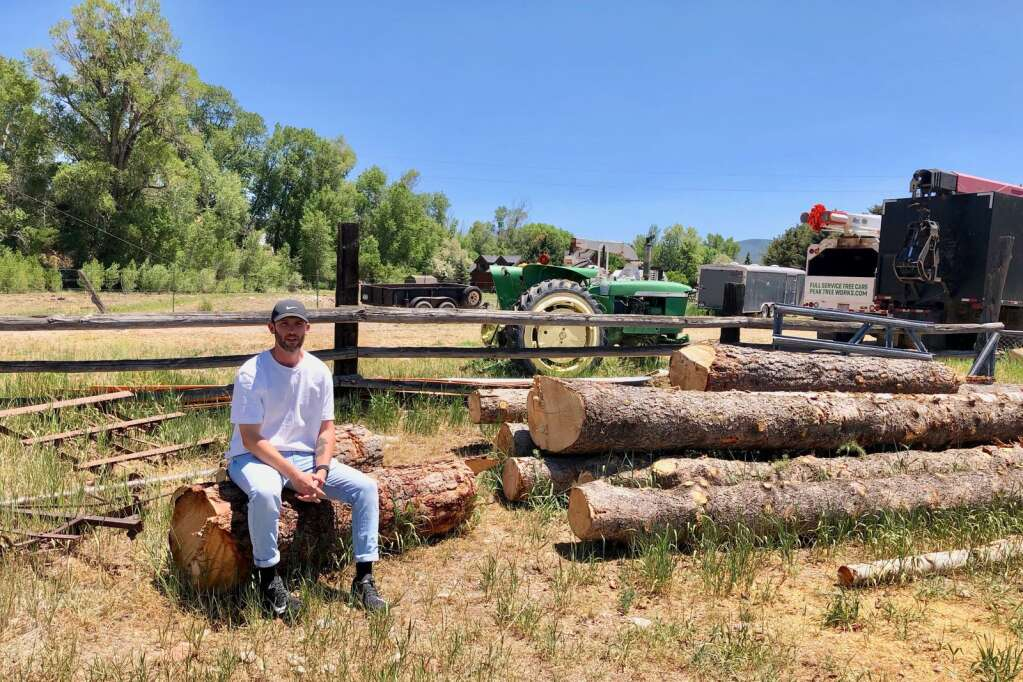 Evan Schreiber sits on the 20-acre property he bought in the midvalley in 2019. He has revised a development plan for The Fields.   Scott Condon/The Aspen Times