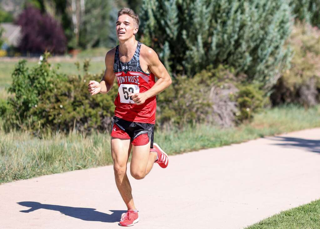 Montrose's Jonas Graff competes in the Longhorn Invitational cross country meet on Saturday, Aug. 28, 2021, at Crown Mountain Park in El Jebel. Photo by Austin Colbert/The Aspen Times.
