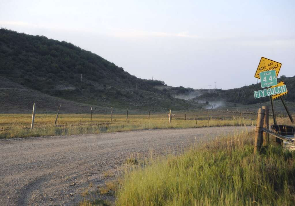 The lead of the  SBT GRVL black course pack descends fly gulch early Sunday morning. (Photo by Shelby Reardon)