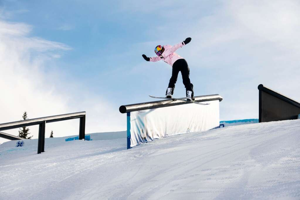 Austrian snowboarder Anna Gasser slides down a rail feature on the slopestyle course during a practice session at the 2021 X Games Aspen on Thursday, Jan. 28, 2021. (Kelsey Brunner/The Aspen Times)