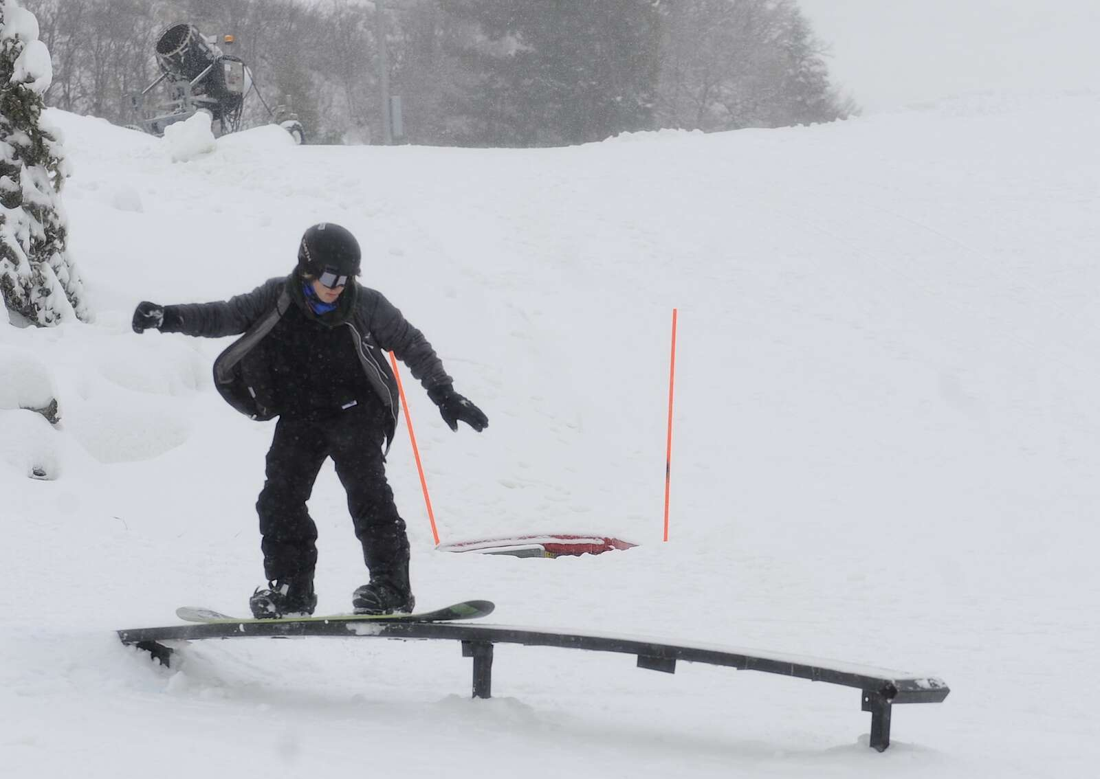 Luca Martorano improves his snowboarding skills at a free, public rail jam at Howelsen Hill on Saturday.