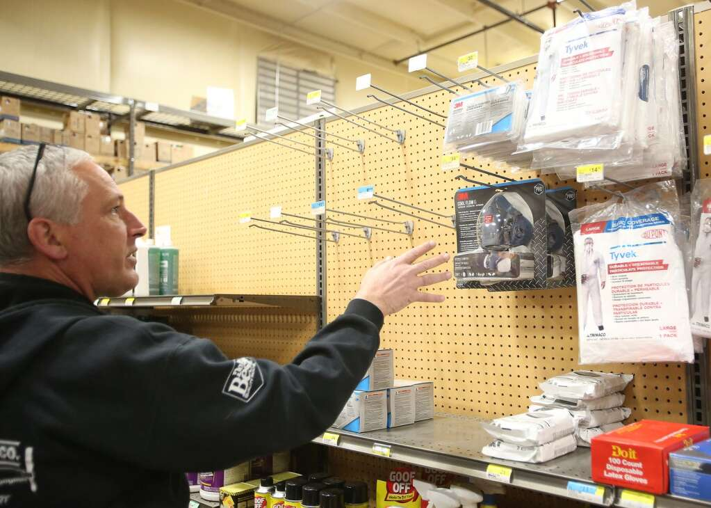 Hills Flat Lumber assistant store manager Steve Waldron shows the only two masks left on the shelves of the Grass Valley hardware store Mar. 24. All N100 and N95 masks fly off of the shelves when shipments come in. Waldron says masks are on back order until April. | Photo: Elias Funez